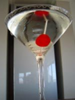 Sweet martini garnished with a cocktail cherry